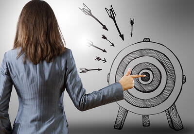 Rear view of businesswoman pointing at drawn target