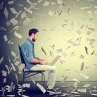 Young man using a laptop building online business making dollar bills cash falling down. Beginner IT entrepreneur under money rain. Success economy concept-889100-edited.jpeg